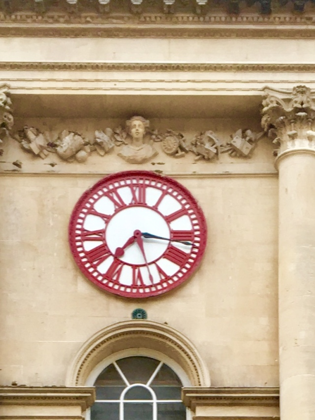 The Corn Exchange clock, showing the 2nd minute hand, ten minutes behind GMT © Sarah Murden